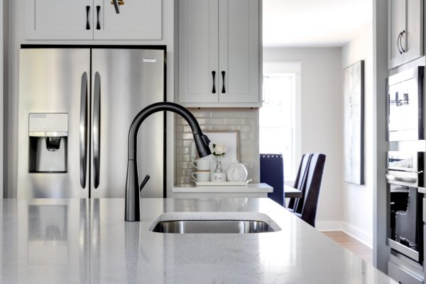 Kitchen faucet in island of renovated home by Richmond Hill Design-Build