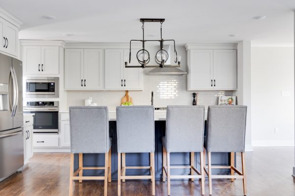 Two-toned kitchen cabinetry in renovated home by Richmond Hill Design-Build
