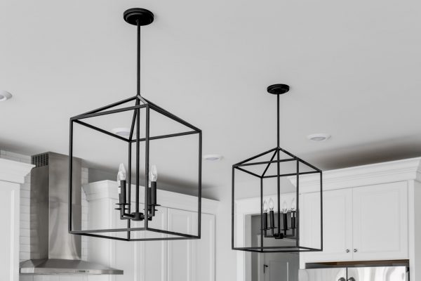 Cage pendant lights in kitchen in home built by Richmond Hill Design-Build
