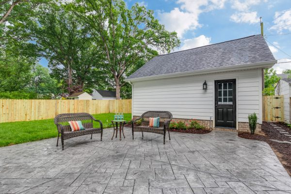 Stamped concrete patio in backyard of beautiful new home built by Richmond Hill Design-Build