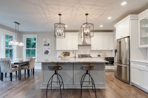 Kitchen with island and cage pendants in home built by Richmond Hill Design-Build