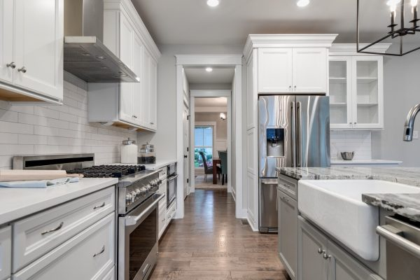 Kitchen with wood floors in home built by Richmond Hill Design-Build