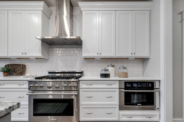 Kitchen with stainless steel appliances and island in home built by Richmond Hill Design-Build