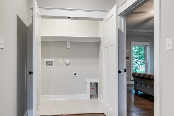 Laundry closet in home built by Richmond Hill Design-Build