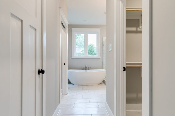 Beautiful owner's bathroom with freestanding tub in renovated home by Richmond Hill Design-Build