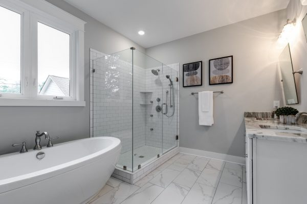 Beautiful owner's bathroom with corner shower in new home by Richmond Hill Design-Build