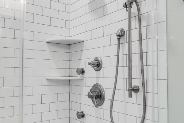 Subway tile shower in owner's bathroom in renovated home by Richmond Hill Design-Build