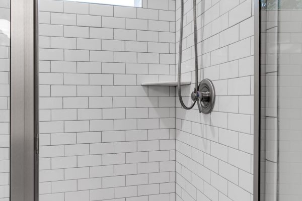 Shower with subway tile in renovated home by Richmond Hill Design-Build