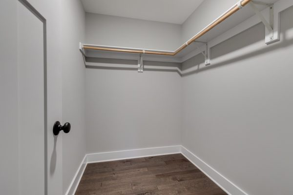 Owner's walk in closet in renovated home by Richmond Hill Design-Build