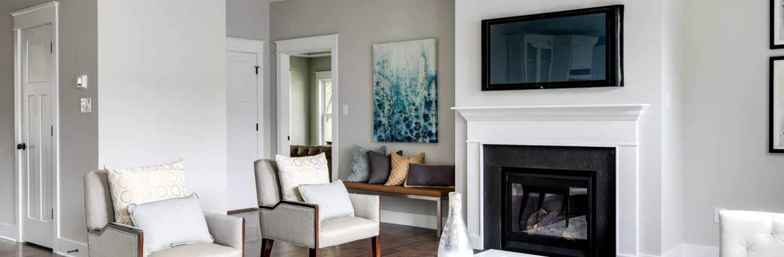 Family room with linear fireplace in home built by Richmond Hill Design-Build