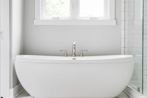 Freestanding tub in beautiful owner's bathroom in renovated home by Richmond Hill Design-Build