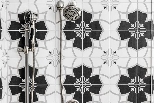 Vintage pattern tile in owner's shower in townhouse by Richmond Hill Design-Build