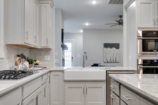 Farmhouse sink in kitchen of new townhouse by Richmond Hill Design-Build
