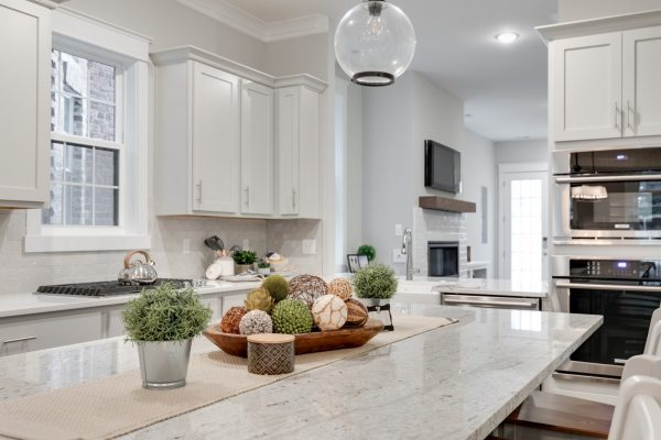 Kitchen island with pendant lights in new townhouse by Richmond Hill Design-Build