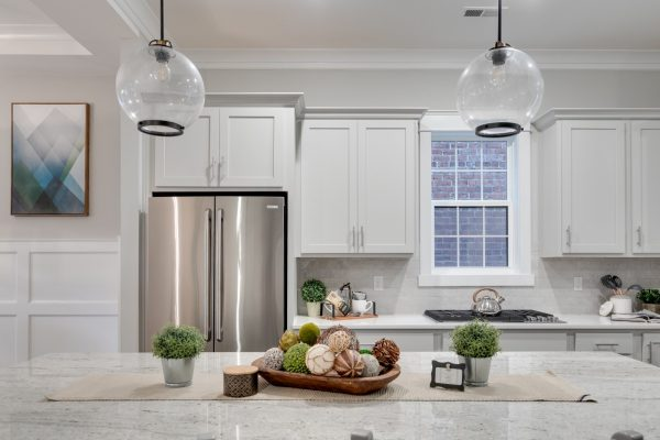 Pendant lights over island in kitchen of new townhouse by Richmond Hill Design-Build