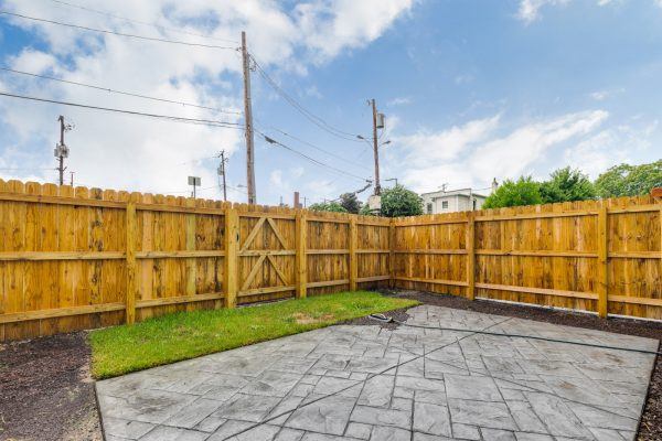 Rear fenced yard of townhouse by Richmond Hill Design-Build