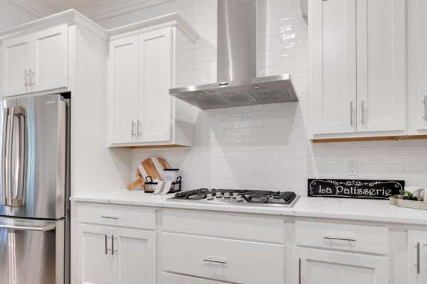 Range hood and cook top of kitchen in new townhouse by Richmond Hill Design-Build