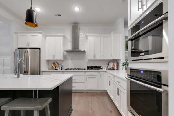 Beautiful island in kitchen of new townhouse by Richmond Hill Design-Build