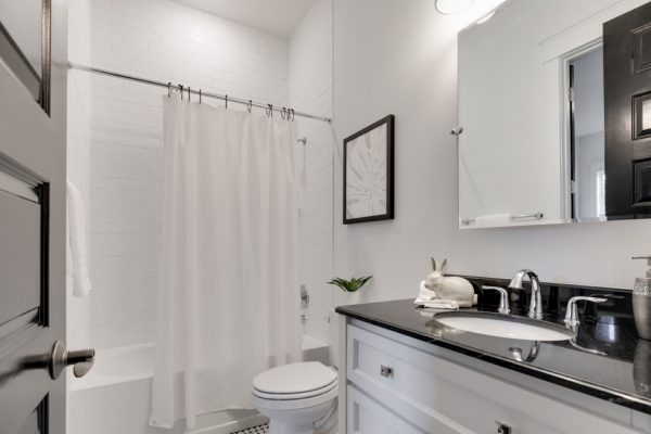 Guest bathroom in beautiful new townhouse by Richmond Hill Design-Build