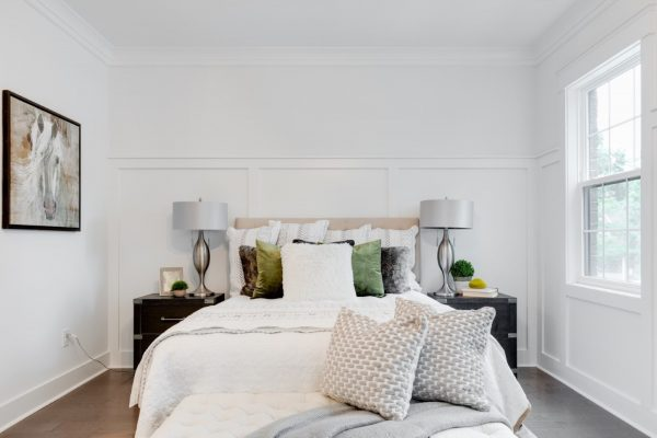 Beautiful bed in owner's bedroom in new townhouse by Richmond Hill Design-Build