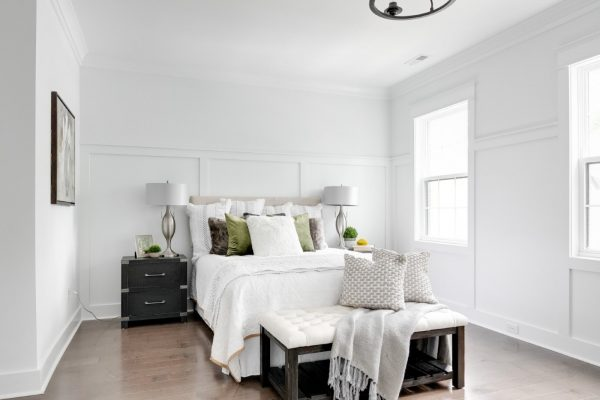 Beautifully dressed bed in owner's bedroom in new townhouse by Richmond Hill Design-Build