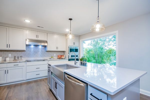 Gorgeous kitchen with island in renovated ranch home on Lake Cherokee by Richmond Hill Design-Build