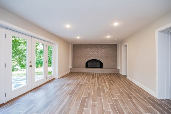 Rec room with fireplace in gorgeous renovated ranch home by Richmond Hill Design-Build