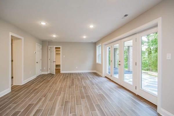 Rec room with lake access in gorgeous renovated ranch home by Richmond Hill Design-Build