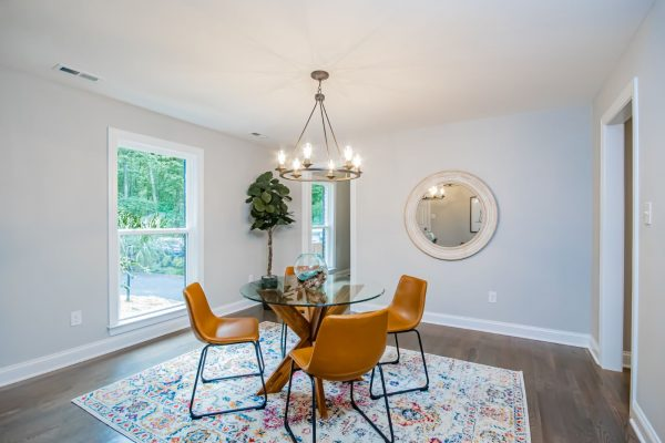 Dining room of renovated ranch home on Lake Cherokee by Richmond Hill Design-Build