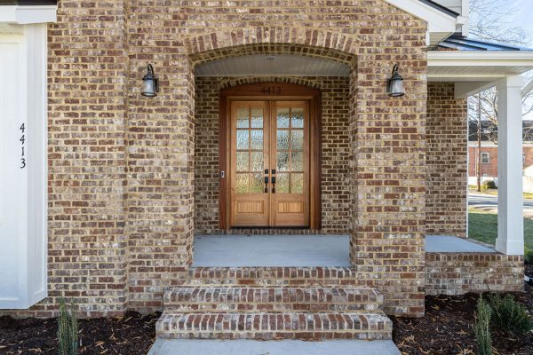 Brick front porch and double front doors of new home built by Richmond Hill Design-Build