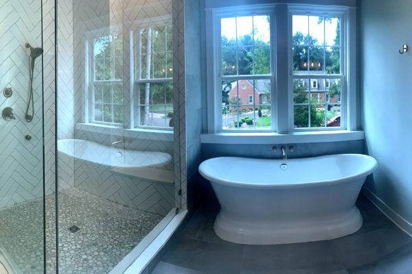Tub and shower in primary bathroom in new home built by Richmond Hill Design-Build