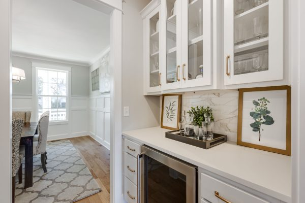 Butler's pantry with wine fridge in new home built by Richmond Hill Design-Build