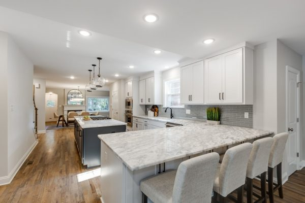Eat at peninsula in kitchen of renovated Tudor home by Richmond Hill Design-Build