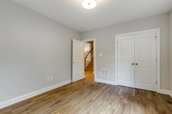 First floor bedroom in renovated home by Richmond Hill Design-Build